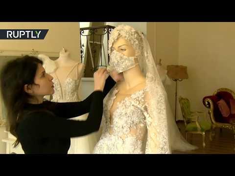 خياطة كمامات تُناسب فساتين الزفاف وتقي العروس من عدوى كورونا
