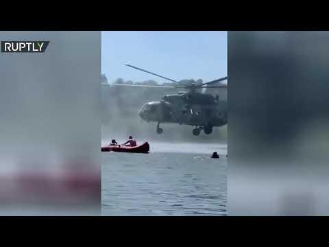 شاهد طائرة هليكوبتر تكاد تلامس رؤساء أشخاص يسبحون في أوكرانيا